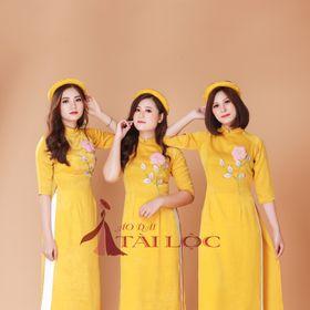xưởng may áo dài bưng quả vàng vải gỗ giá sỉ