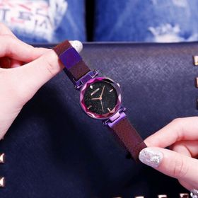 Đồng hồ nam châm nữ